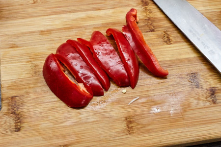 Slice the peppers and then dice. for chicken with vegetables in sour-sweet sauce