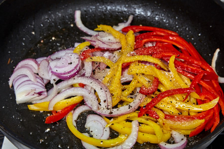 Add sugar, salt, and pepper in the frying pan for pork with a sweet pepper