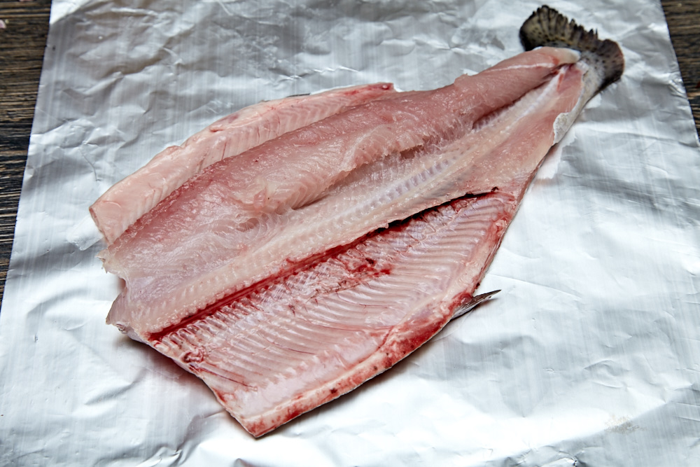 Place the trout opened on the foil for rainbow trout with Herbs and Tomatoes in the Foil