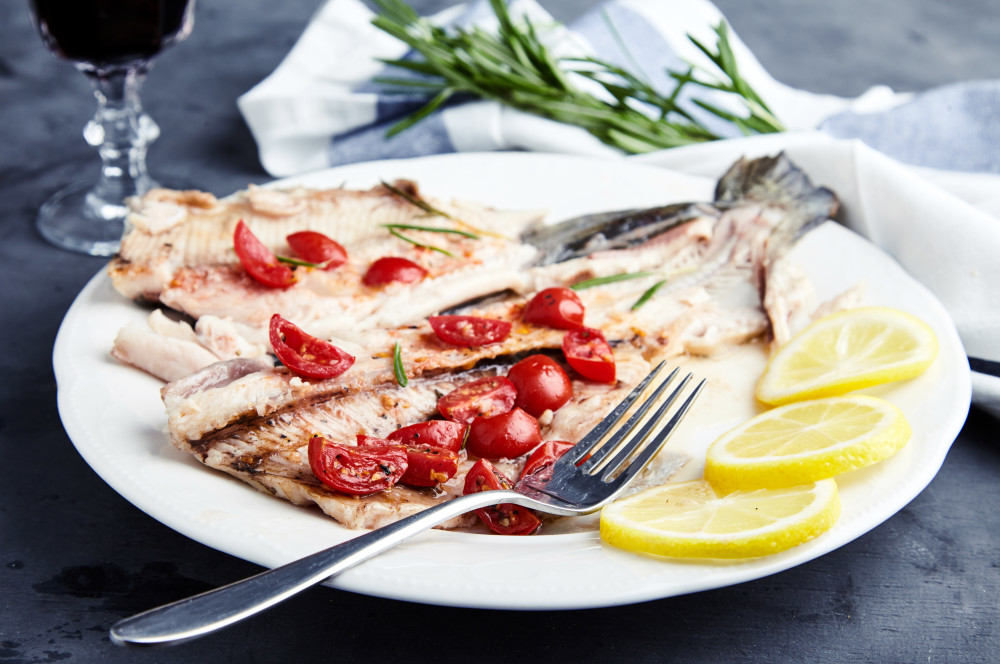 Serve the rainbow trout with Herbs and Tomatoes in the Foil