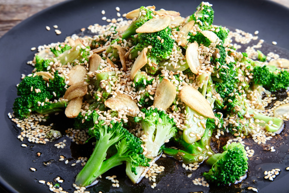 Serve while hot asian broccoli with soy sauce and ginger