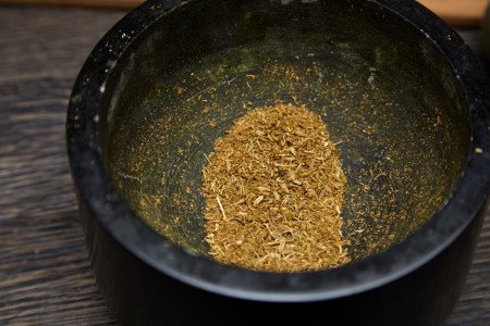 Mix spices in the mortar for texas style pork loin