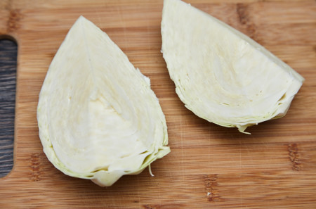 Cut halves into quarters for chinese fried cabbage