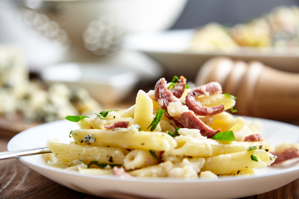 Add cheese on top for penne pasta with celery sauce