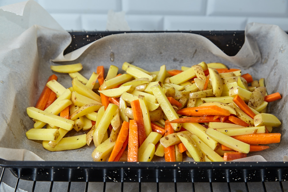 Put the potatoes and carrots to the pan for roasted fish and chips with aioli