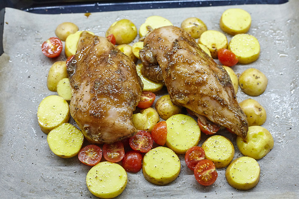 Place the marinated breasts on top for gentle chicken breasts baked with vegetables in balsamic-honey marinade