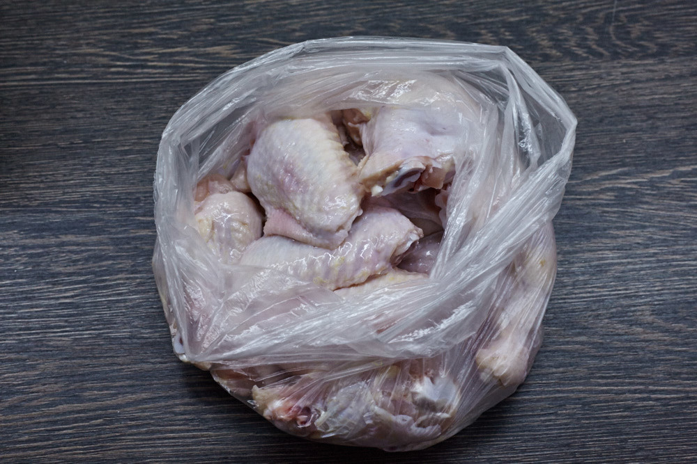 Dry wings place into the bag for roasted buffalo wings