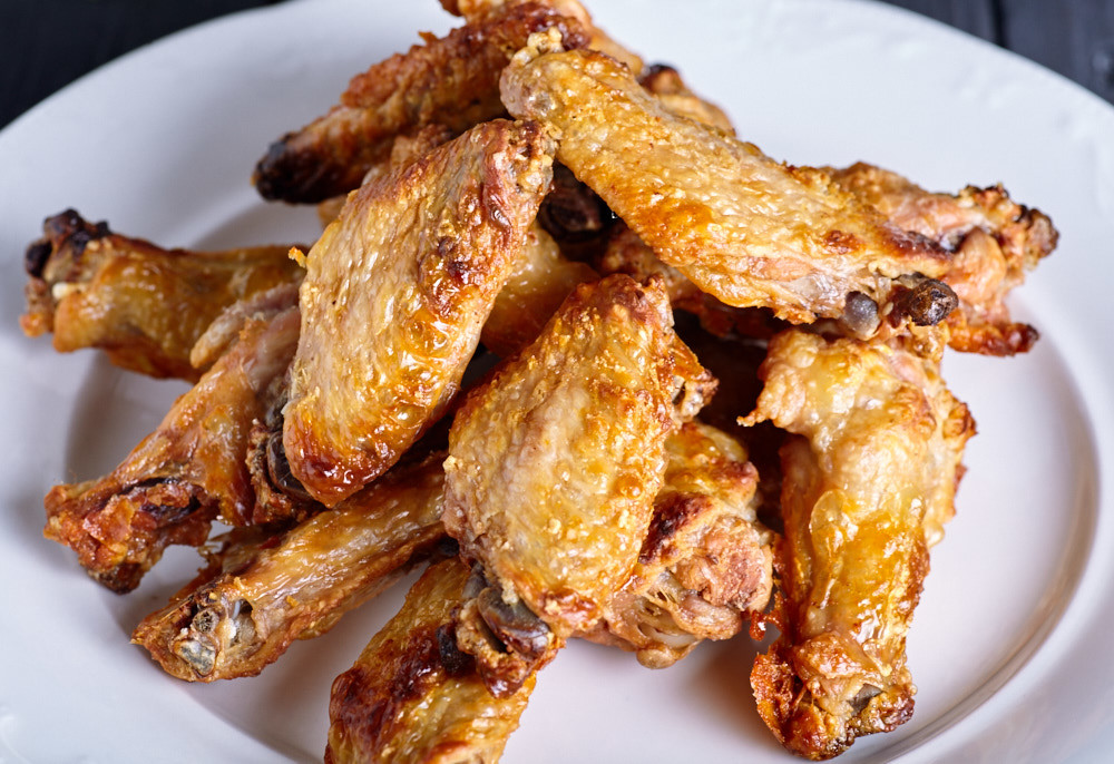 Put the wings on the serving plate for roasted buffalo wings