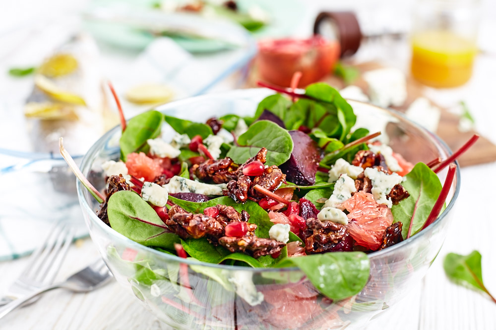 Add dressing for beetroot and spinach salad with caramelized nuts and citrus vinaigrette dressing
