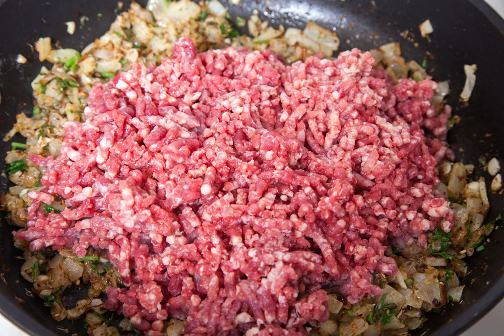 Add meat to the frying pan for American Chop Suey