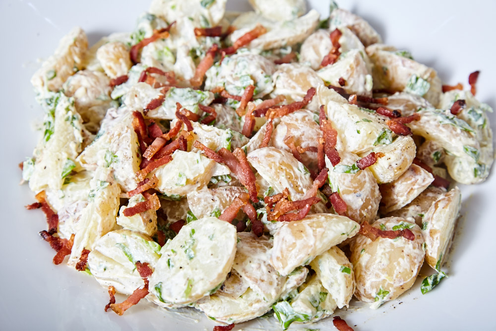 Place fried bacon on top for jamie oliver's potato salad with a bacon