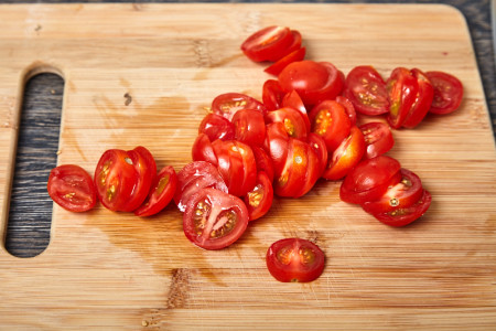 Tomatoes slice in circles for fan shaped baked eggplants with tomatoes and feta cheese