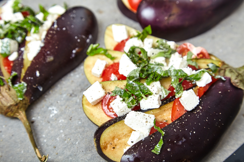 Salt, pepper, and finely sprinkle with olive oil for fan shaped baked eggplants with tomatoes and feta cheese