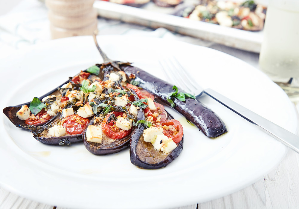 Put on the plate, add a bit of fresh chopped basil and serve fan shaped baked eggplants with tomatoes and feta cheese