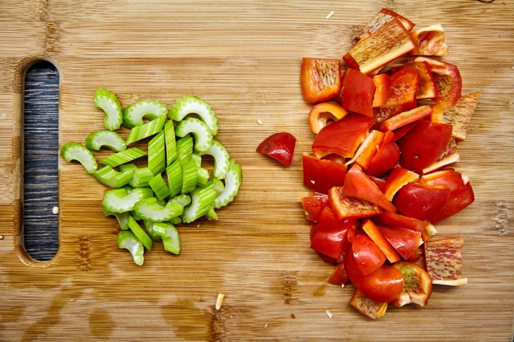 Chop sweet pepper and celery for Gordon Ramsay's vegetable curry