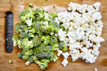 Divide broccoli and cauliflower head into small flowers for Gordon Ramsay's vegetable curry