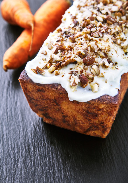 Decorate the pie with walnuts for carrot pie with mascarpone and lime icing