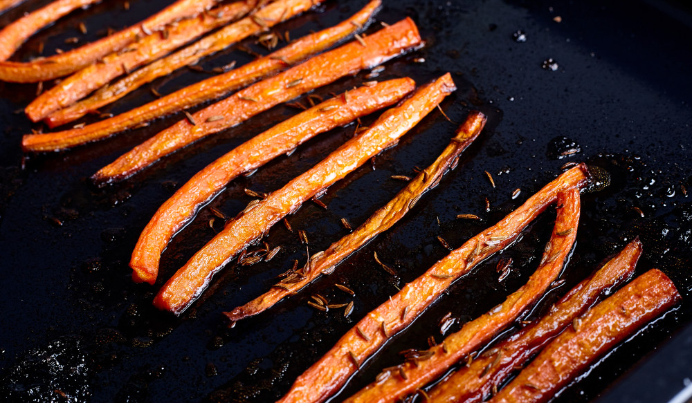 Serve glazed carrots with thyme while hot