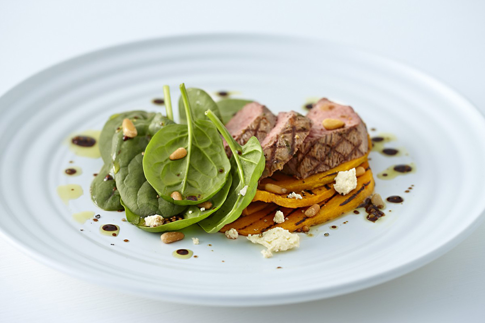 #7.  Salad with young lamb, pumpkin, spinach and pine nuts.