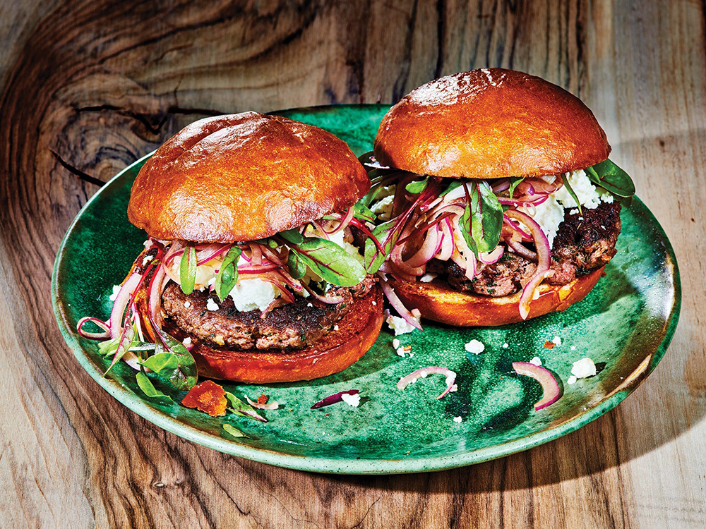 #32 Lamb burger with feta, mint, and pickled onions.
